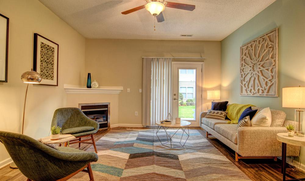 A living room that is great for entertaining at The Park at Three Oaks in Wilmington, NC