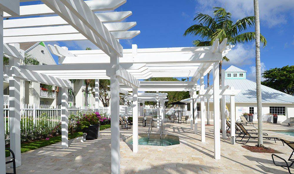 Swimming Pool Area at Cypress Club Apartments in Tamarac