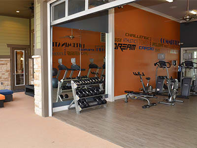 Fitness center at Springs at Country Club Apartments in Lake Charles
