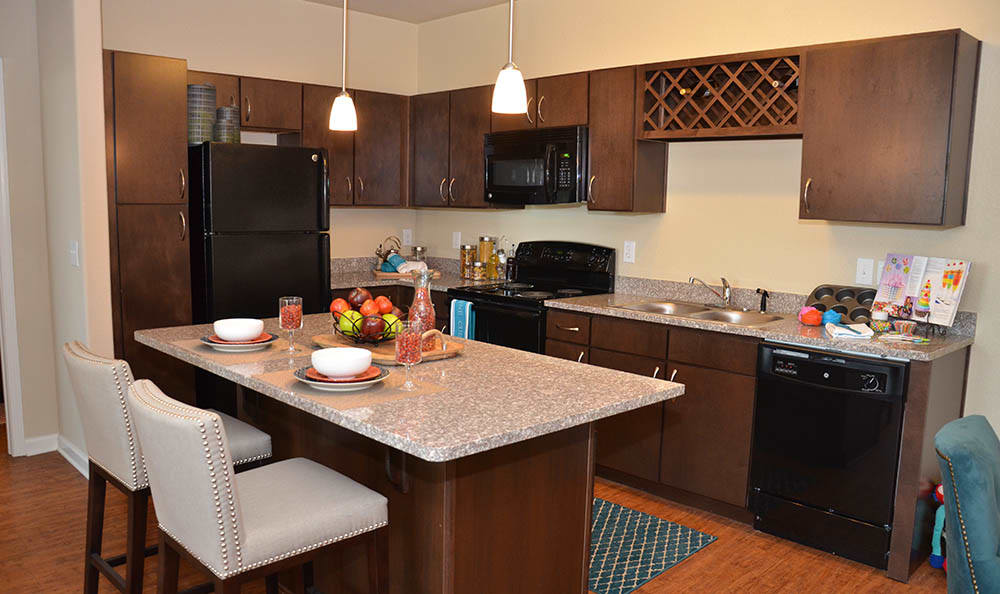 Kitchen Island At Springs at Alamo Ranch Apartments