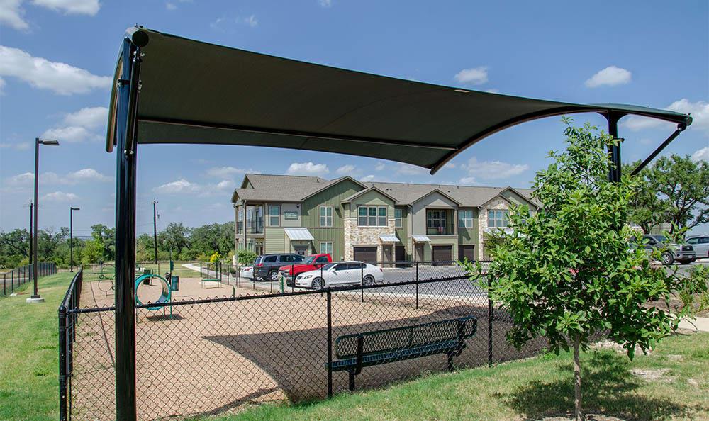 Springs at Alamo Ranch Apartments Shaded Dog Park Area In San Antonio