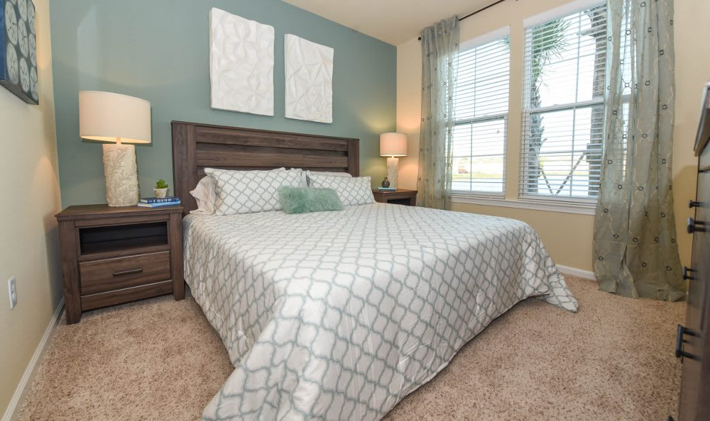 Well decorated bedroom at Springs at Country Club Apartments in Lake Charles