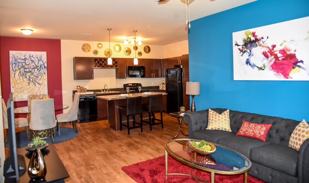 Kitchen, dining room and living room at Springs at Fremaux Town Center Apartments