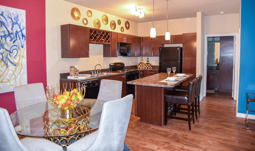 Kitchen and dining area at Springs at Fremaux Town Center Apartments in Slidell