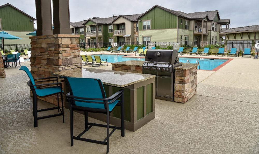 Poolside at Springs at Fremaux Town Center Apartments in Slidell