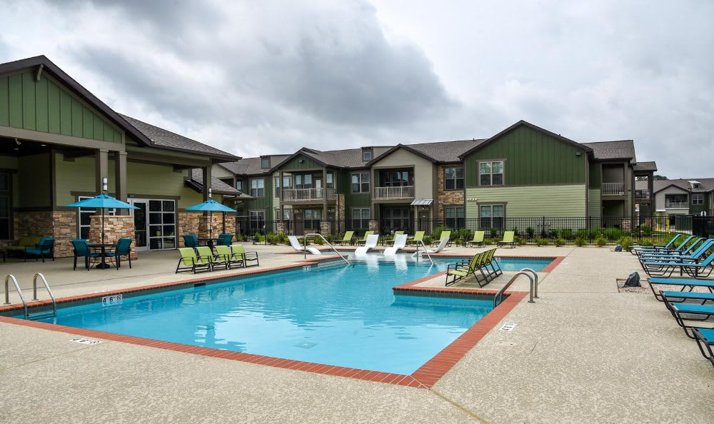 Refreshing swimming pool at Springs at Fremaux Town Center Apartments in Slidell