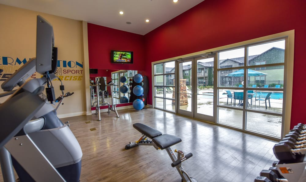 Fitness center at Springs at Fremaux Town Center Apartments in Slidell
