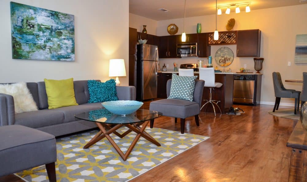 Living room and kitchen at Springs at Liberty Township Apartments in Liberty Township
