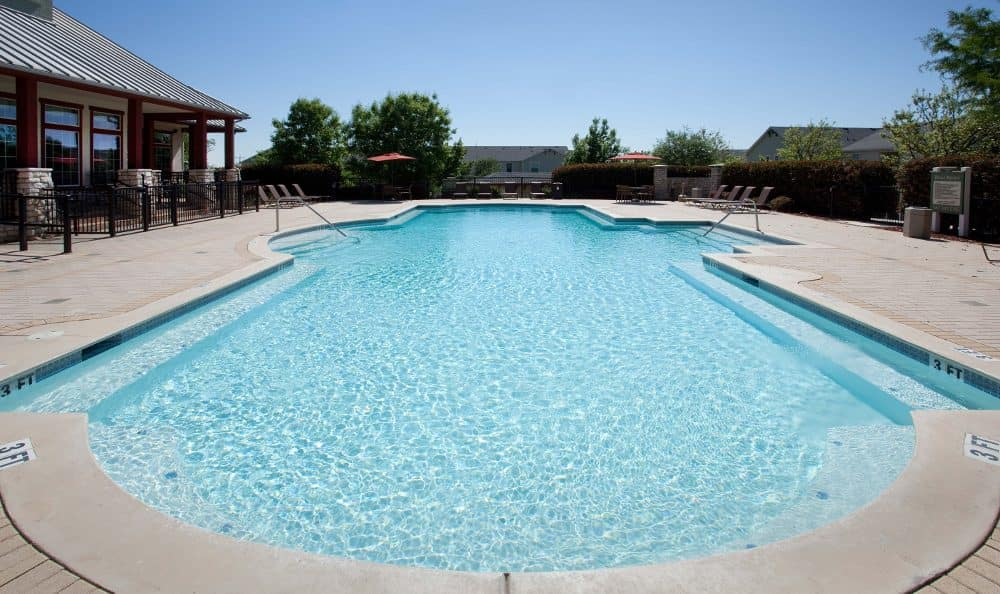 Clubhouse pool at Springs at Live Oak Apartments