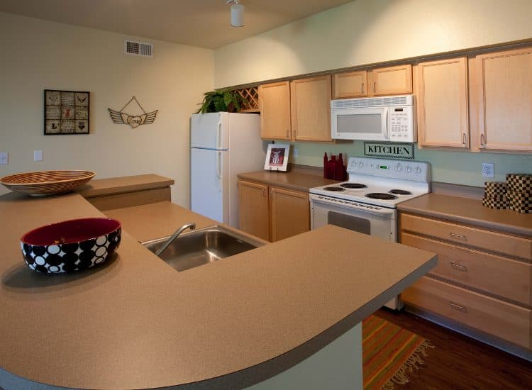 Kitchen at Springs at Live Oak Apartments in Live Oak