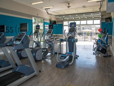 Fitness center at Springs at River Chase Apartments in Covington