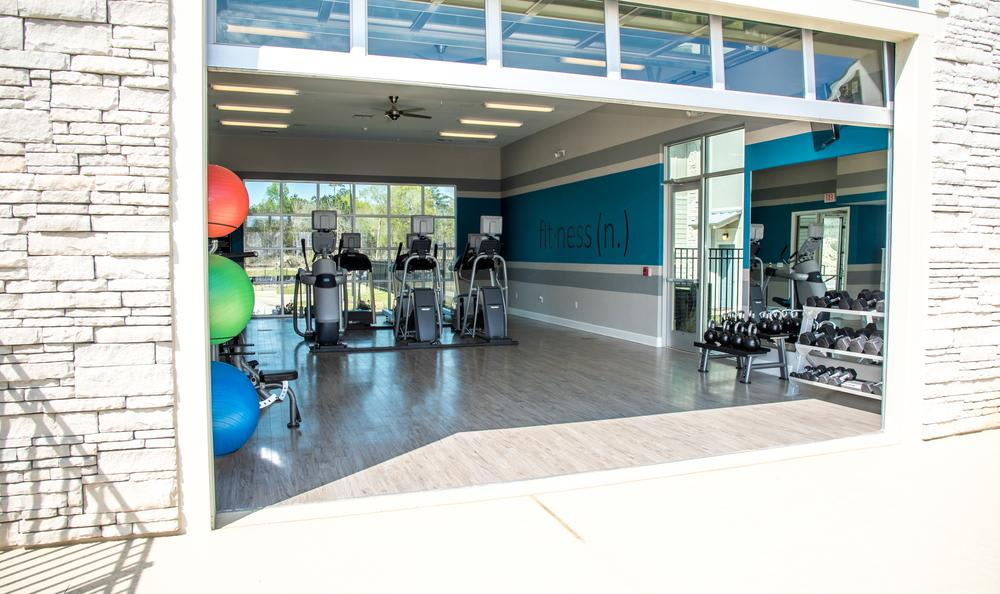 fitness center entrance at Springs at River Chase Apartments in Covington, LA