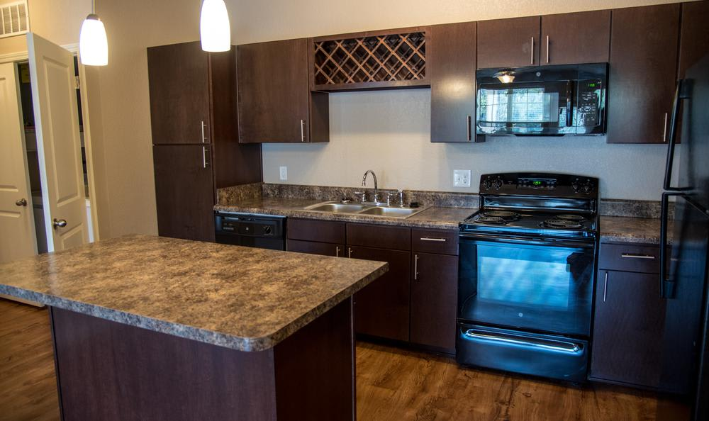 fully equipped kitchen at Springs at River Chase Apartments in Covington, LA