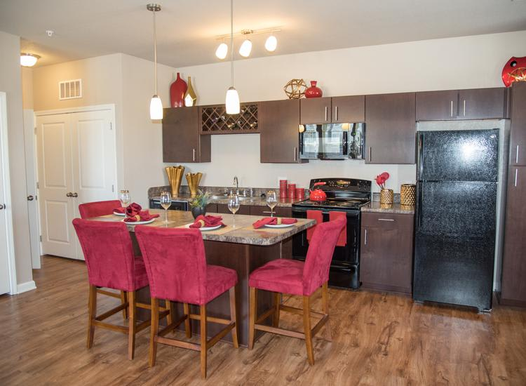 kitchen room and dining table at Springs at River Chase Apartments in Covington, LA