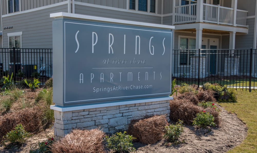 entrance sign at Springs at River Chase Apartments in Covington, LA