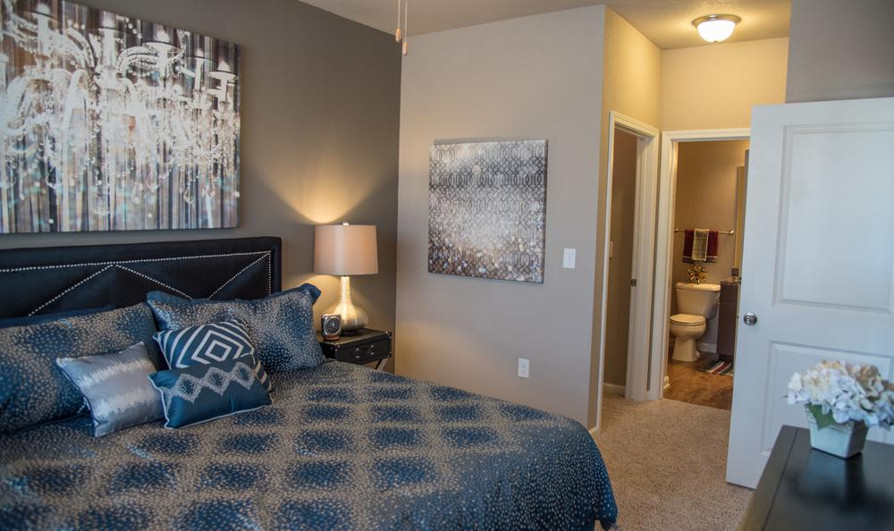 spacious and well decorated bedroom at Springs at River Chase Apartments in Covington, LA