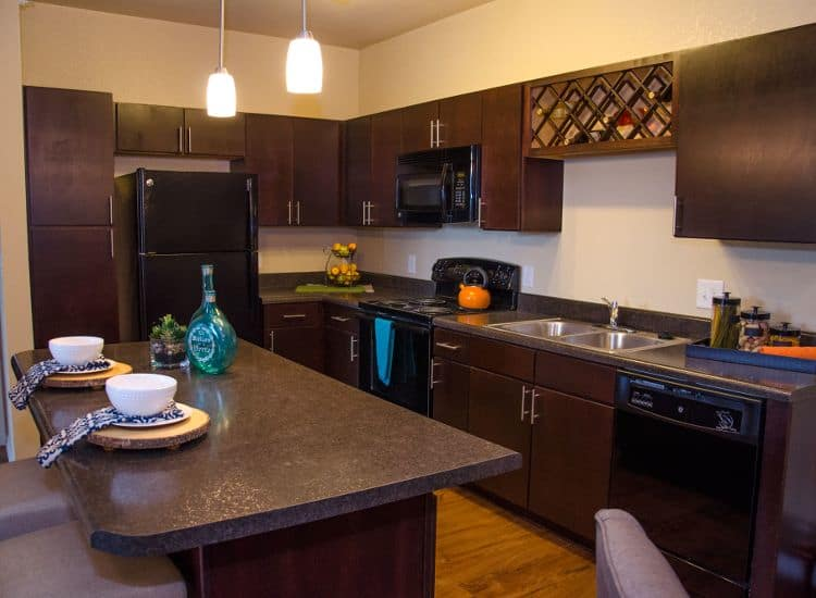 fully equipped kitchen at Springs at Waukee Apartments in Waukee, IA