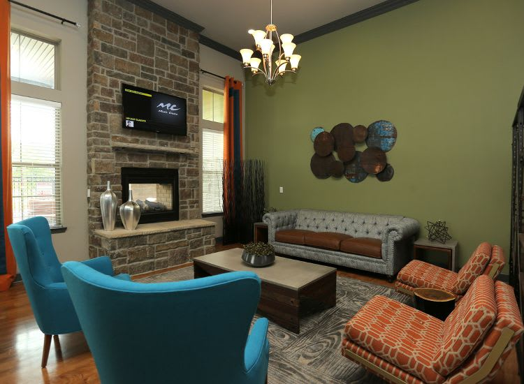 living room with chimney at Springs at Woodlands South Apartments in Tulsa, OK