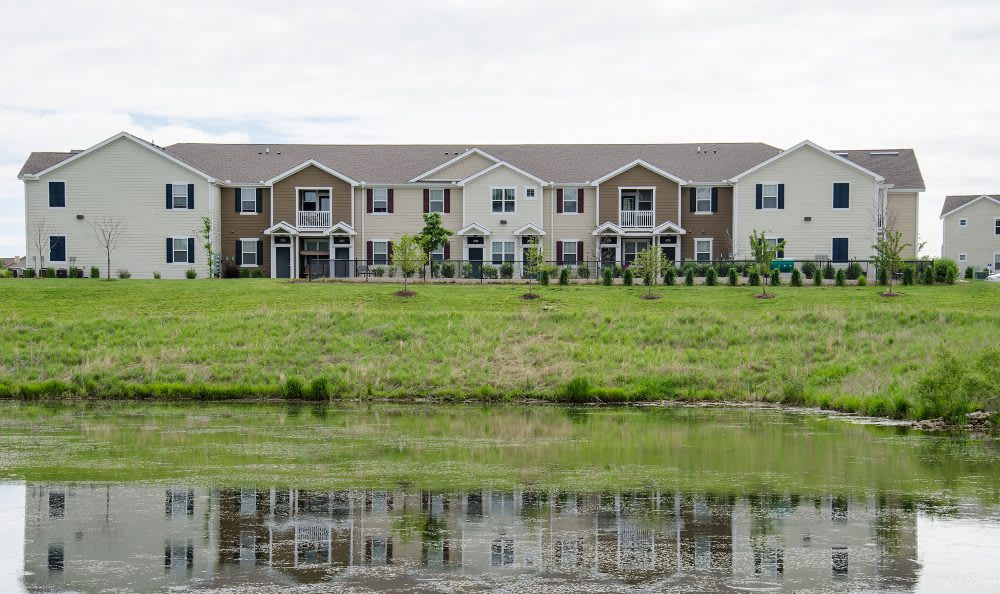 Building exterior and creek at Springs at Bettendorf