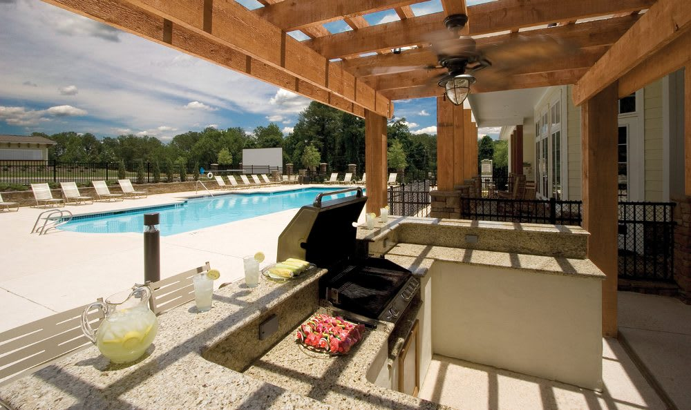 Outdoor kitchen and pool view at Springs at Greystone in Birmingham