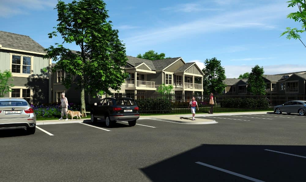 Apartments' exterior and parking at Springs at Allison Valley in Colorado