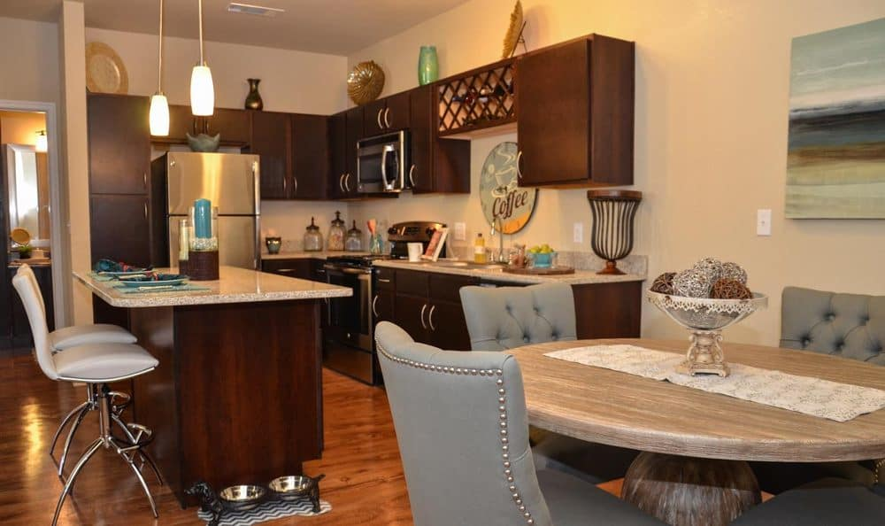 Updated kitchen and dining area at Springs at Allison Valley in Colorado Springs