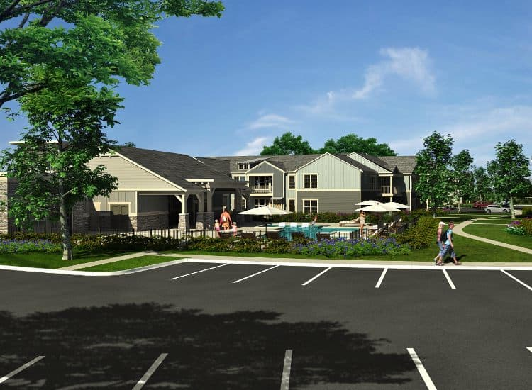 Apartments and parking at Springs at Allison Valley in Colorado Springs, CO