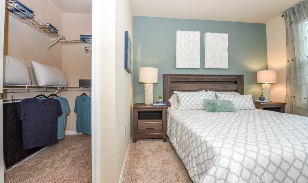 Bedroom with walk-in closet at Springs at Six Mile Cypress