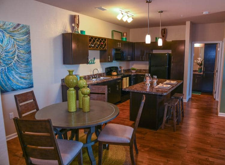 Kitchen and dining at Springs at Six Mile Cypress in Fort Myers