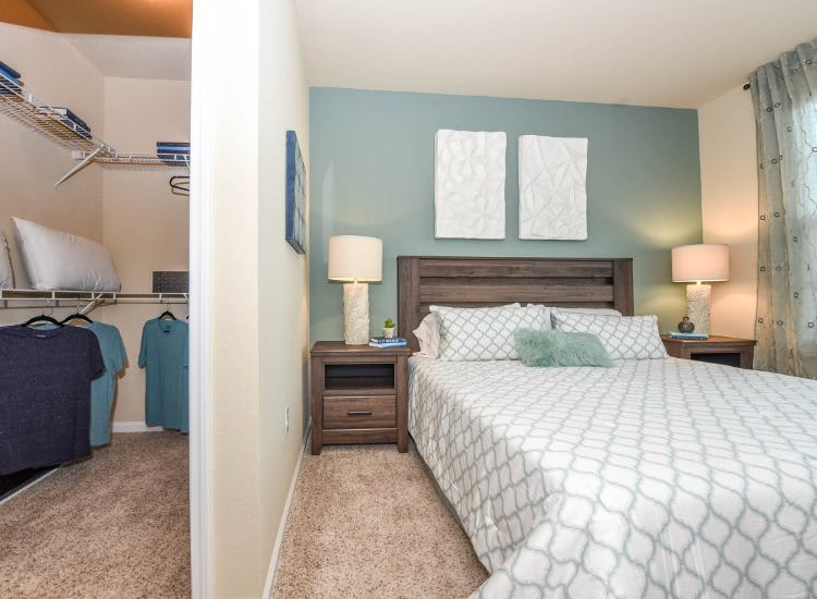Bedroom and walk-in closet at Springs at Knapp's Crossing in Grand Rapids