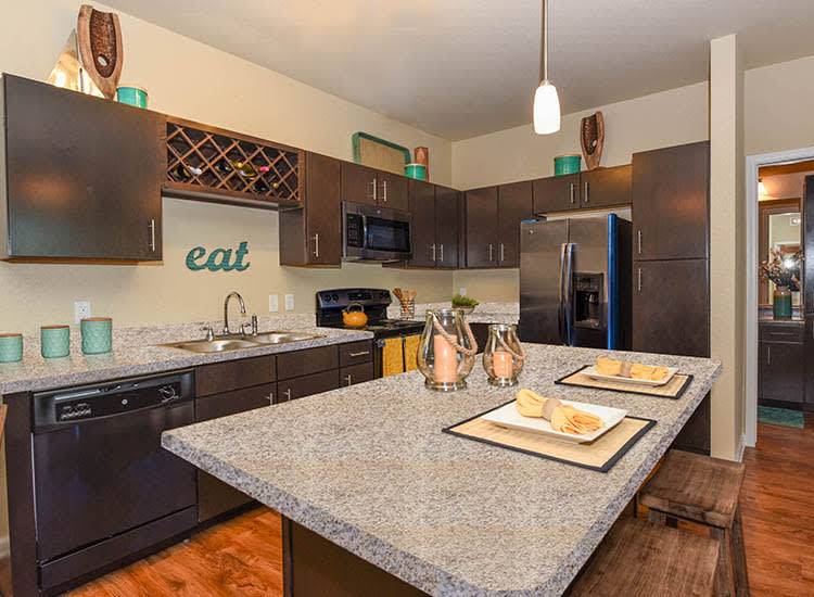 Kitchen With Granite Counter Tops at Springs at Eagle Bend