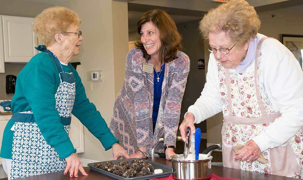 Cooking is one the many activities that the residents love at RobinBrooke Senior Living
