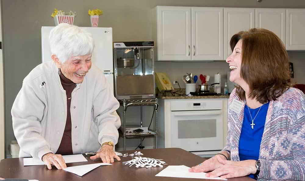 Making snowflakes and laughing at RobinBrooke Senior Living