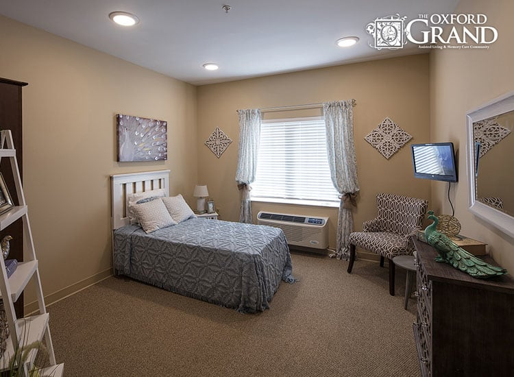 Well decorated bedroom at The Oxford Grand Assisted Living & Memory Care in Kansas City