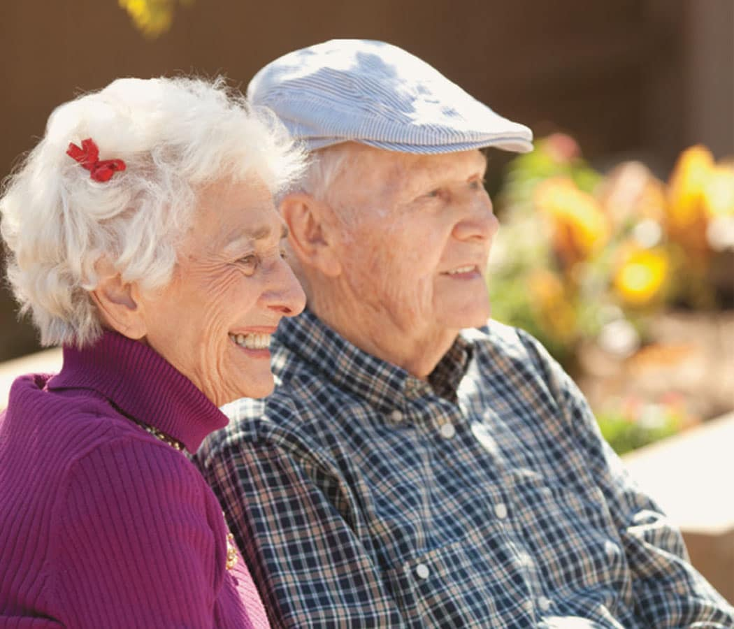 Couple enjoying time outside at Oxford Senior Living