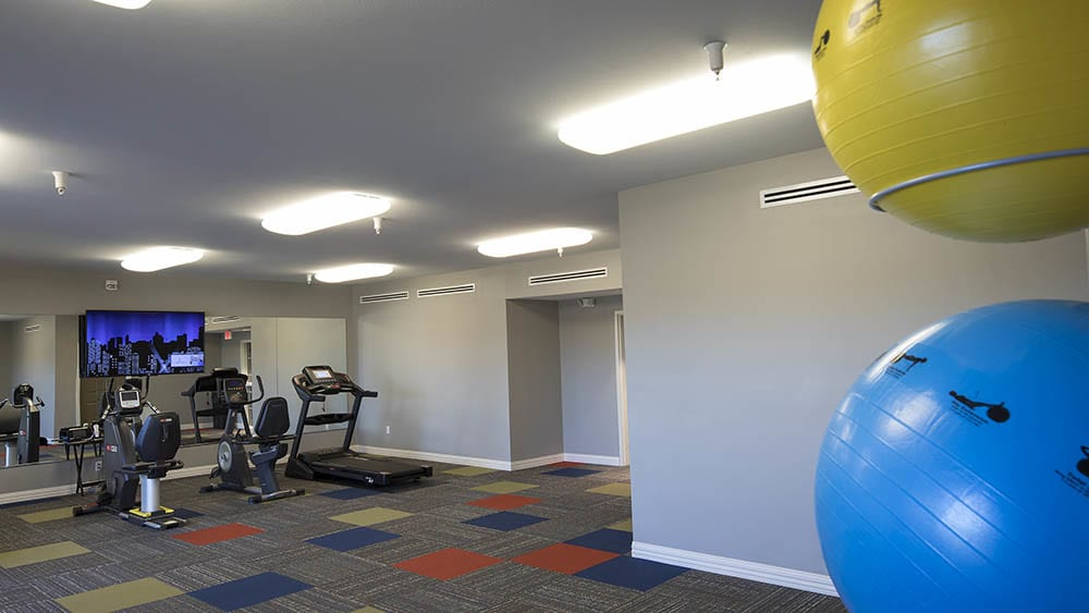 Fitness center with exercise balls at Oxford Villa Active Senior Apartments