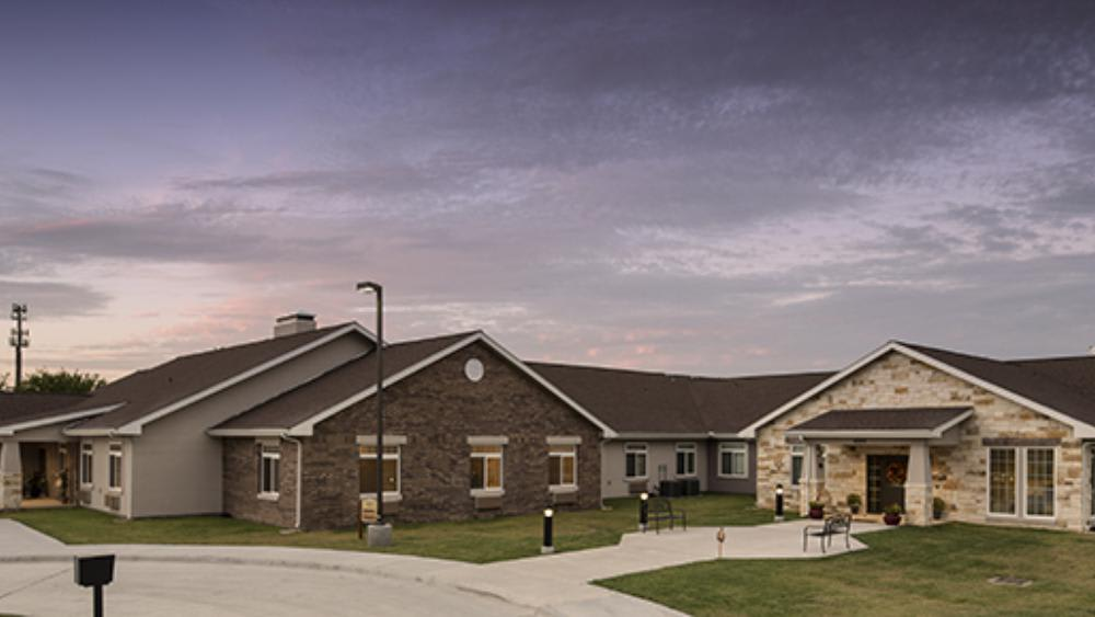 wide walking paths outside of Oxford Glen Memory Care at Grand Prairie in Grand Prairie, TX