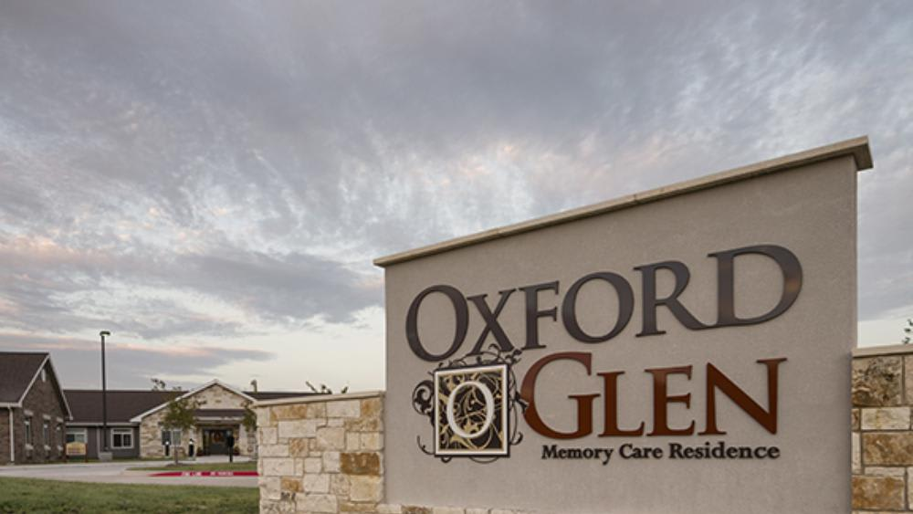 Main sign to Oxford Glen Memory Care at Sachse