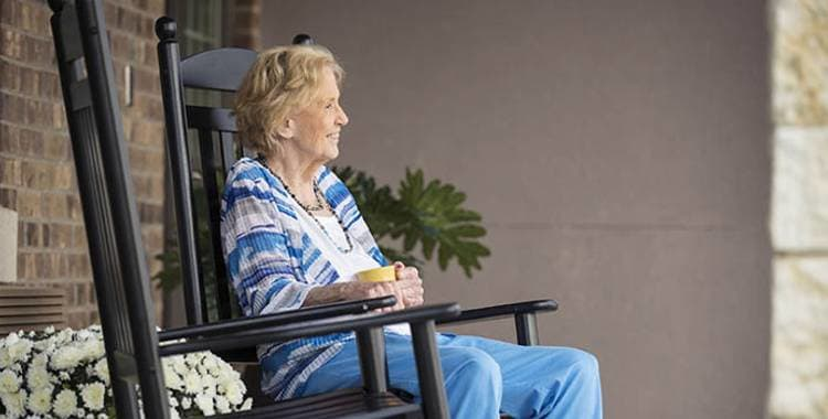 Happy resident living at Oxford Glen Memory Care at Sachse