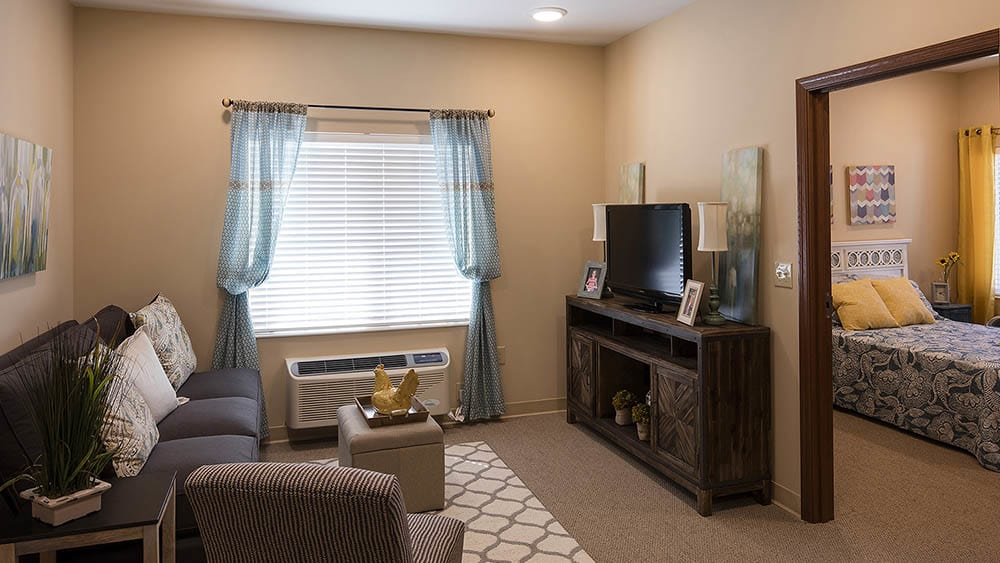 living room inside of our senior apartments at The Oxford Grand Assisted Living & Memory Care in McKinney, Texas