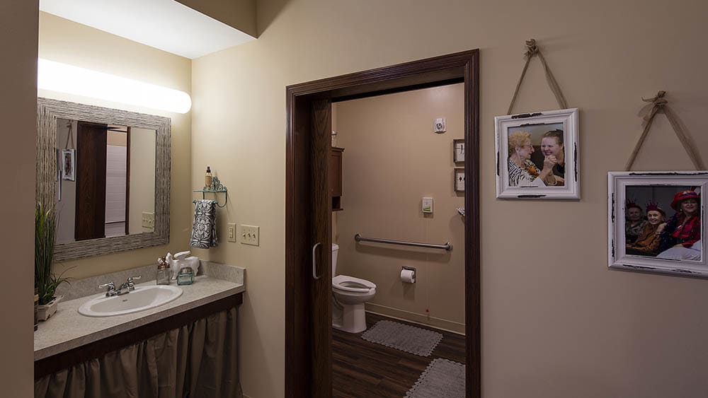Easy to access restrooms at The Oxford Grand Assisted Living & Memory Care in McKinney, Texas