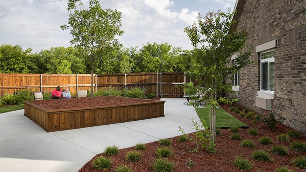 Courtyard and planter box at Oxford Glen Memory Care at Carrollton in Carrollton, Texas