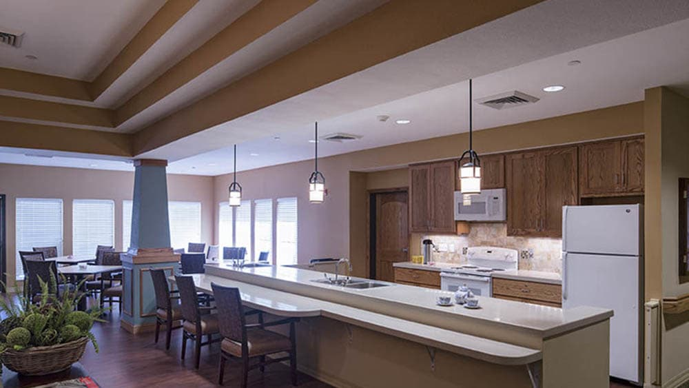 community dining area at Oxford Glen Memory Care at Carrollton in Carrollton, Texas