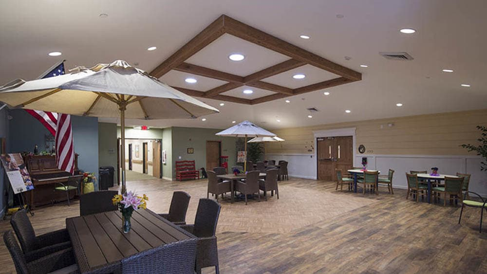 senior clubhouse with outdoor-style seating at Oxford Glen Memory Care at Carrollton in Carrollton, Texas
