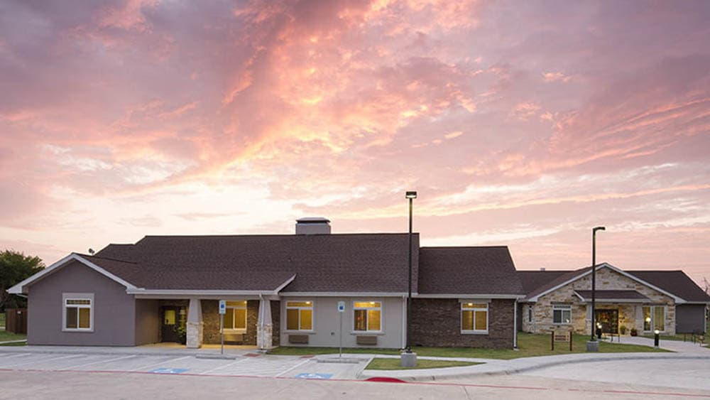 View of Oxford Glen Memory Care at Carrollton at sunset in Carrollton, TX