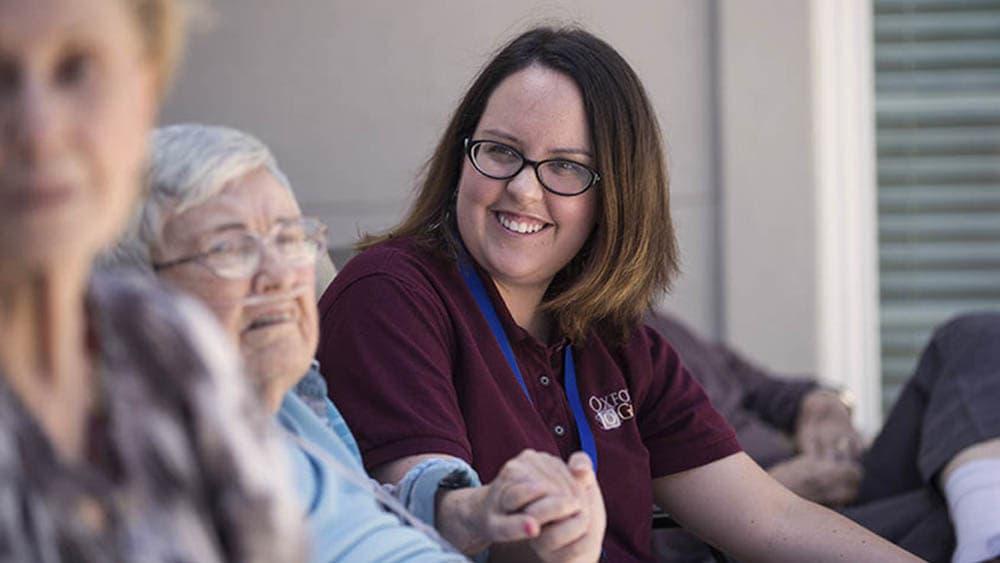 Caretaker with 2 senior women at Oxford Glen Memory Care at Carrollton