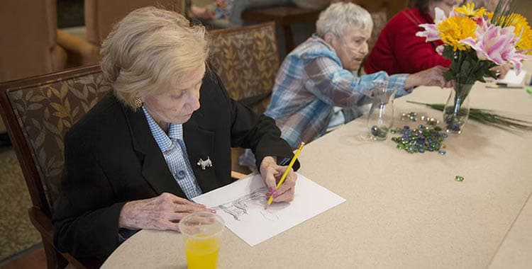Seniors creating art at Oxford Glen Memory Care at Carrollton