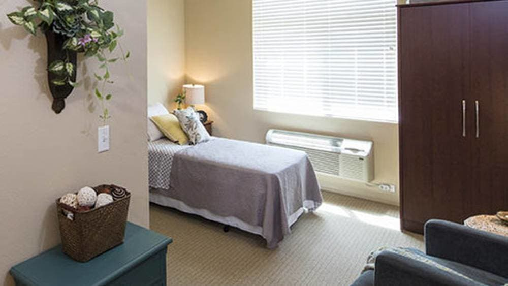 Comfy bedroom at Oxford Glen Memory Care at Owasso in Owasso, OK
