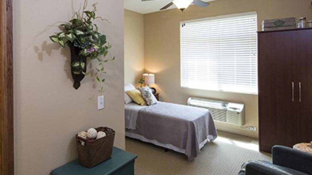 Comfy bedroom at Oxford Glen Memory Care at Grand Prairie