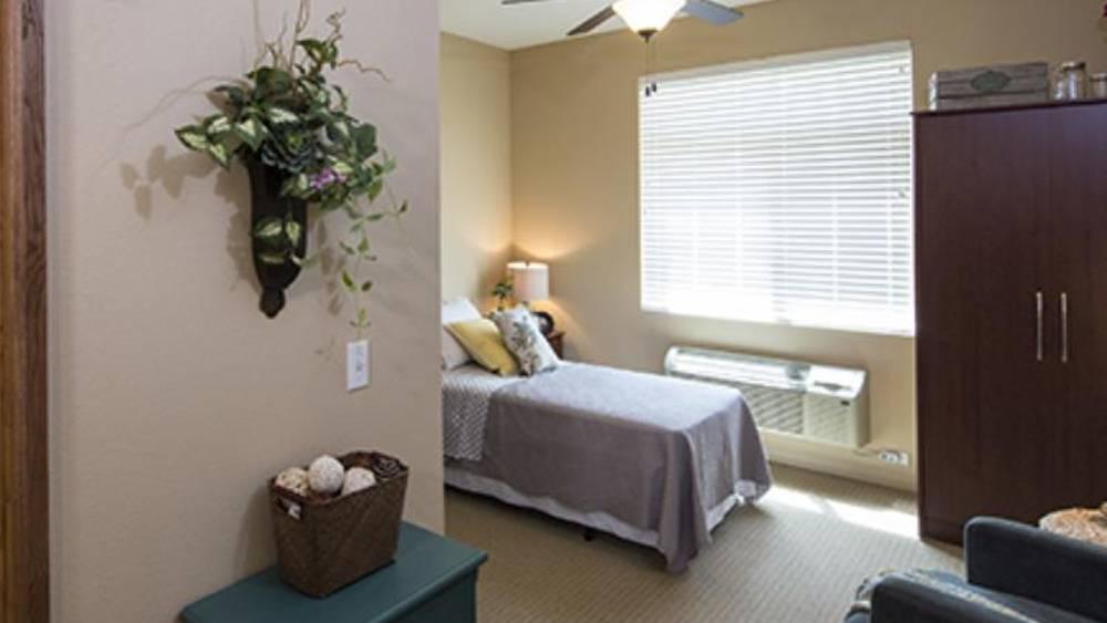 Comfy bedroom at Oxford Glen Memory Care at Grand Prairie